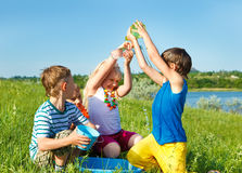 Excited friends pouring water. On each other Royalty Free Stock Photo