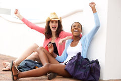 Excited friends at railroad station Royalty Free Stock Photo