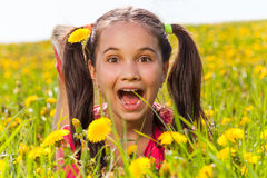 Excited funny girl looking straight in summer Royalty Free Stock Image