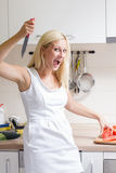 Excited funny woman preparing vegetables Royalty Free Stock Photos
