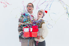 Excited geeky hipster couple looking at confetti Royalty Free Stock Image