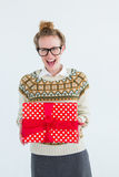 Excited geeky hipster holding present Stock Photography