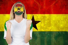 Excited ghana fan in face paint cheering Royalty Free Stock Images