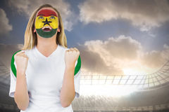 Excited ghana fan in face paint cheering Stock Photos