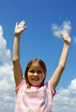 Excited Girl. An excited girl with her arms in the air Stock Photo