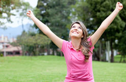 Excited girl with arms up Royalty Free Stock Image