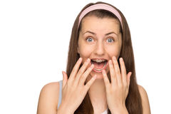 Excited girl with braces shouting isolated Royalty Free Stock Image
