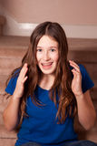 Excited girl with braces. Excited girl wearing orthodontic braces with raised hands Stock Image