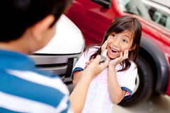 Excited girl buying a car Stock Photo