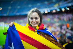 Excited girl with Catalonia flag. Excited positive adult girl with Catalonia flag rooting for football team Stock Images