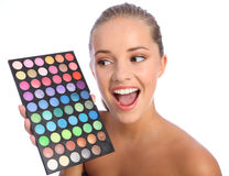 Excited girl cosmetics eyeshadow colour palette Royalty Free Stock Images