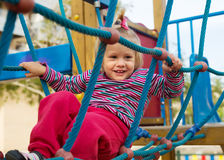 Excited girl developing dexterity at playground Stock Photo