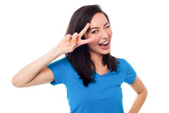 Excited girl doing victory sign on eye Royalty Free Stock Images
