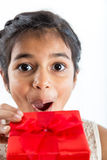 Excited girl gets gift Royalty Free Stock Image