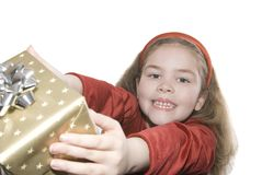 Excited girl grabbing present stock photography