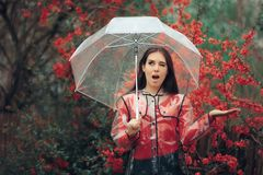 Excited Girl Happy in the Rain Holding Her Umbrella royalty free stock images