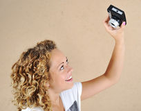 Excited girl with camera Stock Images