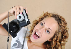 Excited girl with camera Stock Photos