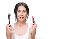 Excited girl holding cosmetic products Stock Photo