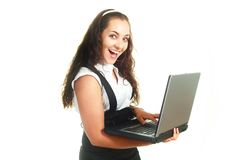 Excited girl holding a laptop Stock Photos