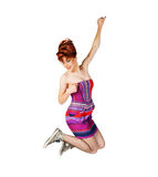 Excited girl jumping high on white Royalty Free Stock Images