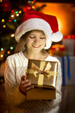 Excited girl looking inside of glittering present box. Portrait of excited girl looking inside of glittering present box Stock Image