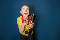 Excited girl with medals and trophy cup Stock Photos