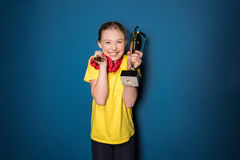 Excited girl with medals and trophy cup Royalty Free Stock Photography
