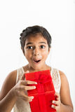 Excited girl opening gift Stock Photos