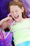 Excited girl on phone Royalty Free Stock Image