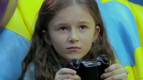 Excited girl playing console game, time waste, entertainment stock footage