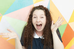 Excited girl. Portrait of a girl with an emotion of admiration and wonder on a colored background stock photos