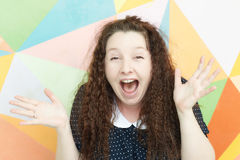 Excited girl. Portrait of a girl with an emotion of admiration and wonder on a colored background royalty free stock photo