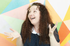 Excited girl. Portrait of a girl with an emotion of admiration and wonder on a colored background stock photography