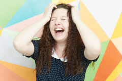 Excited girl. Portrait of a girl with an emotion of admiration and wonder on a colored background royalty free stock photos