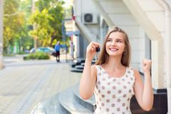 excited girl pumping fist holding keys to the new apartment stock images