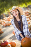 Excited Girl at the Pumpkin Patch Stock Photo