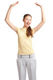 Excited girl with raised arms Stock Photo