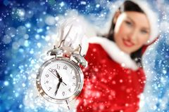 Christmas girl in santa hat. Excited girl with santa hat holding clock. illustration Stock Photo