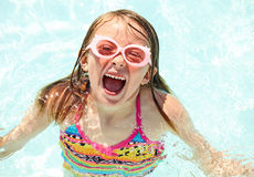 Excited girl screaming with joy in swimming pool Royalty Free Stock Photo