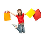 Excited girl with shopping bags. Picture of happy girl with shopping bags Royalty Free Stock Photo