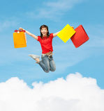 Excited girl with shopping bags. Shopping and motion concept - happy girl with shopping bags Royalty Free Stock Images
