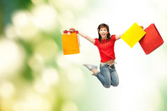 Excited girl with shopping bags. Shopping and movement concept - happy girl with shopping bags Stock Photos