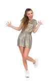 Excited Girl Standing On One Leg Stock Images