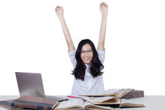 Excited girl studying with books and raise hands Royalty Free Stock Images