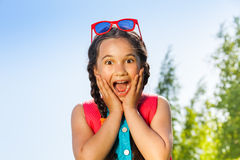 Excited girl with sunglasses portrait Stock Photos