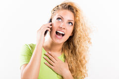 Excited girl talking on the phone Stock Image
