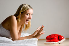 Excited girl by telephone Royalty Free Stock Photos