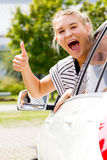Excited girl with thumb up. Excited girl in her new car with thumb up Royalty Free Stock Photo