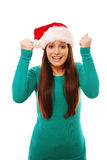 Excited girl wearing santa hat Royalty Free Stock Photography